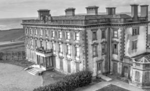 A black and white drone image of Loftus Hall